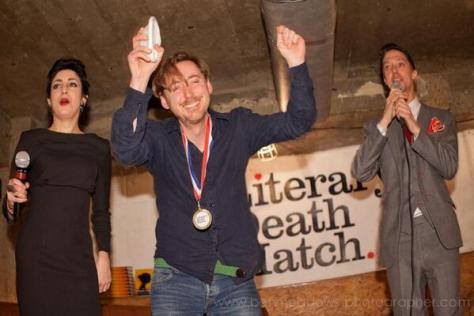 Me celebrating my Literary Death Match win, flanked by Suzanne Azzopardi and Adrian Todd Zuniga